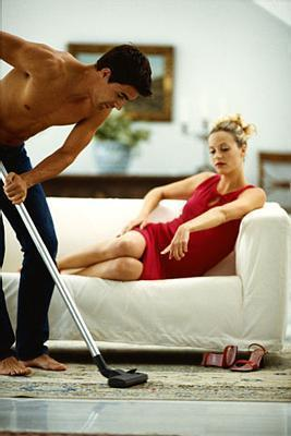 man Vacuums for his Woman - as it should be